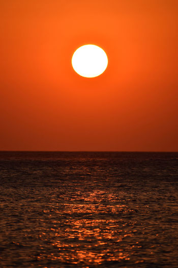 Insanely beautiful sunset, with the sun diving into the sea. Diving Holiday Wave Beauty In Nature Crete Horizon Horizon Over Water Idyllic Into The Sea Nature No People Orange Color Outdoors Red Color Red Sky Rippled Scenics - Nature Sea Sky Sun Sunlight Sunset Tranquil Scene Tranquility Water