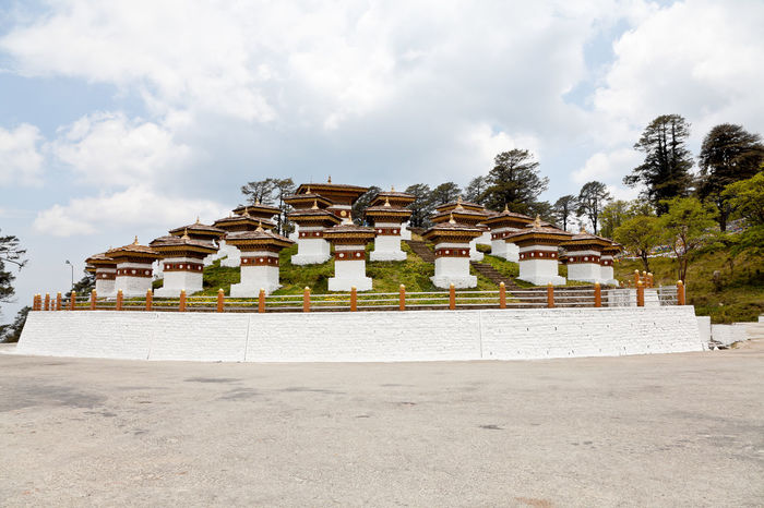 View of Dochula Stupas at Dochula Pass in Bhutan DochulaPass Punakha View Ancient Civilization Architecture Bhutan Building Exterior Built Structure Cloud - Sky Day Daylight Famous Place History Landmark Landscape Nature No People Outdoors Place Of Worship Religion Sky Spirituality Travel Destinations White