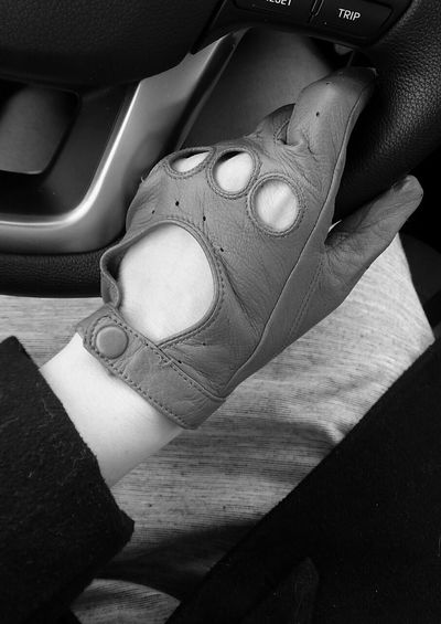 Close-Up Of Woman Hand Gripping Steering Wheel