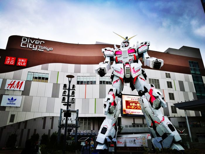 Diiver City Tokyo, Odiaba, Gundam EyeEm Selects Odaiba Odaiba Tokyo Gundam Build Fighter City Orthographic Symbol Communication Text Street Art Business Finance And Industry Neon Sky Architecture Close-up This Is Strength