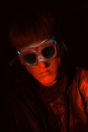 Close-up portrait of boy wearing illuminated goggles
