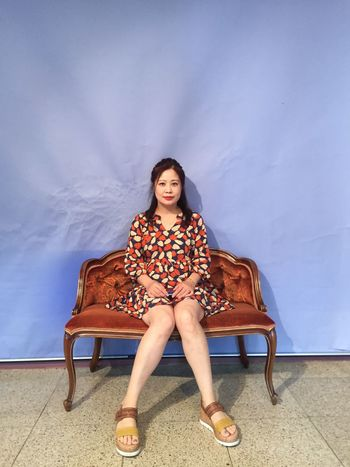 Full Length One Person Sitting Young Adult Sofa Portrait Front View Chair Relaxation Leisure Activity Young Women Indoors  Day Beautiful Woman Seat Real People One Young Woman Only Sky People