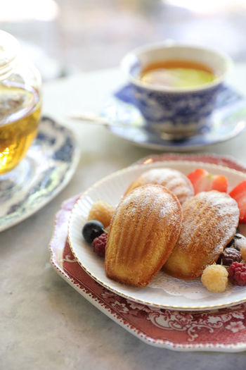 Madeleine Food And Drink Food Drink Freshness Plate Table Refreshment Still Life Sweet Food Ready-to-eat Mug Cup No People Indoors  Coffee Cup Selective Focus Coffee - Drink Focus On Foreground Crockery Meal Breakfast Temptation French Food Hot Tea