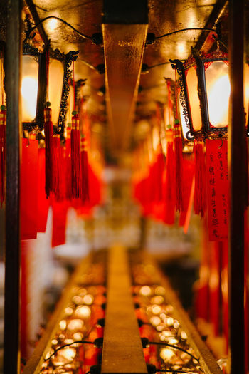 Illuminated lantern hanging in temple outside building