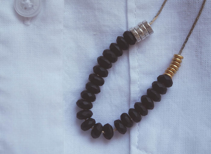 Accuracy Adornment Beads Close-up Faceted Gemstones Jewelry Man Made Object Metallic Necklace No People Onix Part Of Repetition Shirt Spiral Still Life