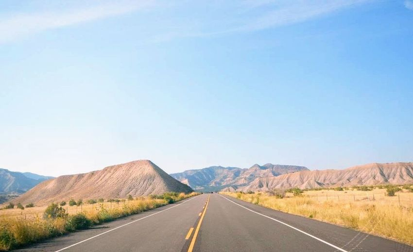 Road Sky Mountain The Way Forward Landscape Transportation Non-urban Scene Direction Nature Scenics - Nature Beauty In Nature Day Tranquil Scene Copy Space No People Sign Mountain Range Tranquility Environment Land Outdoors Dividing Line Arid Climate
