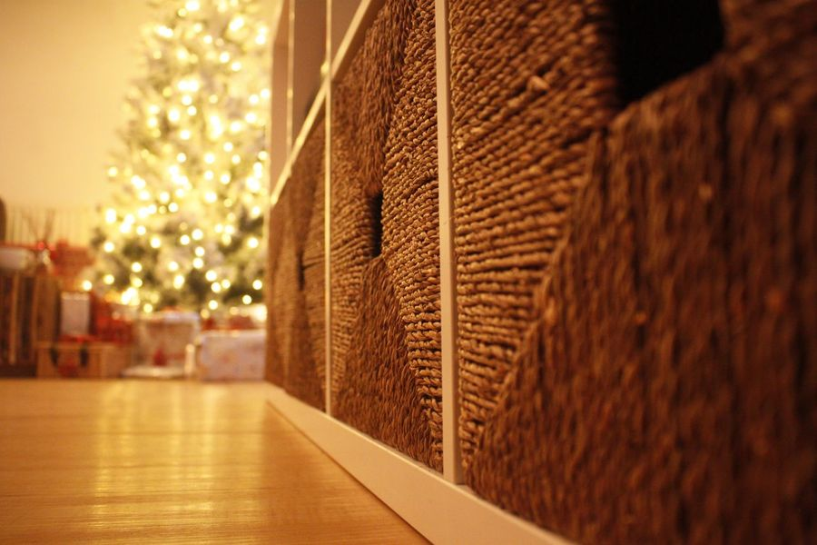 Warm Wicker Christmas Laminate Floor Low Angle View Holidays Festive Xmas IKEA Indoor Tree Lights Wicker Box Selective Focus Christmas Tree Presents Christmas Wicker Storage Wicker