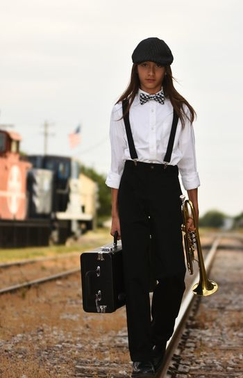 One Person Portrait Musical Instrument Musician Art Is Everywhere Texas Photographer Eyeemphotography Front View Looking At Camera Suitcase Bag Fashion Adult Casual Clothing People Luggage Adults Only Looking Down Black Color Outdoors Young Adult Day Lifestyles Standing TCPM Break The Mold