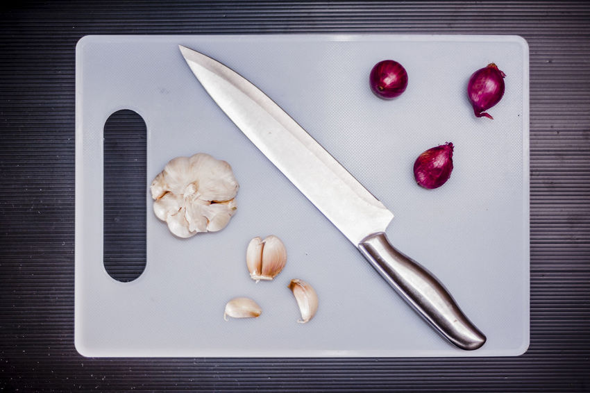 Chopping Board Commercial Cooking Cutting Boards Cuttlery Food Foodphotography Garlic Ingredients Kitchen Knife Objects Onion Stainless Steel Knife Still Life Photography Subject Vegetable