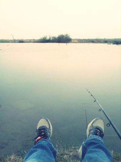 fishing Fishing The Traveler - 2018 EyeEm Awards Low Section Water Standing Human Leg Lake Shoe Men Reflection Personal Perspective Sky