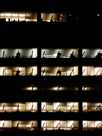 Overtime. Architecture Backgrounds Black Built Structure City Darkness And Light Illuminated Manhattan Night Night Lights Nightlife No People Outdoors Overtime Travel Destinations Window Finding New Frontiers The Graphic City Colour Your Horizn