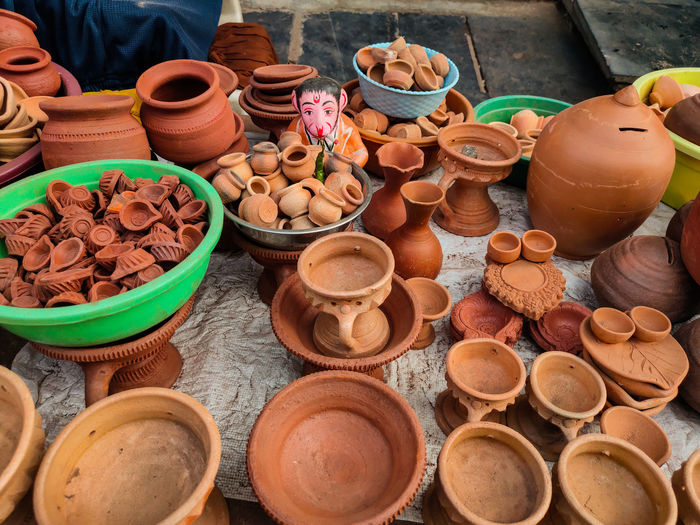 High angle view of various earthenware for sale at market