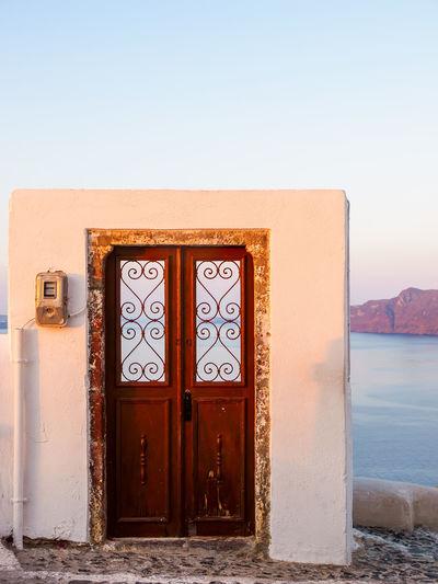 Wooden door to nowhere. santorini island