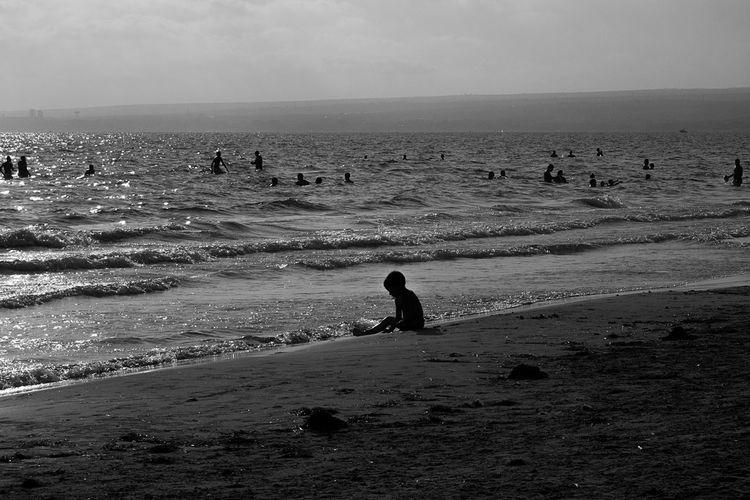 Silhouette man on beach against sky