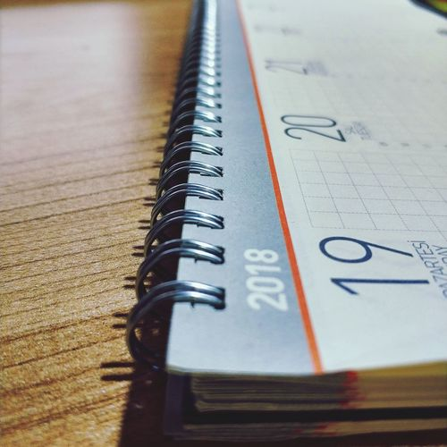 Close-Up Of Calendar On Table