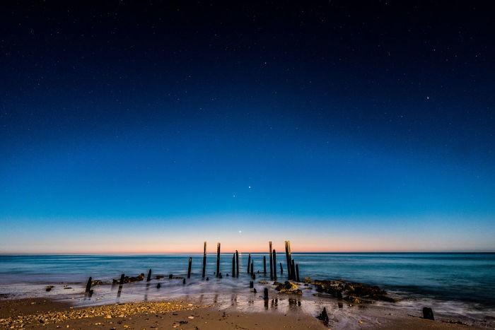 Mother nature is truly beautiful. Sunset Beach Rocks Sand Shore Fujifilm Goldenhour Landscape Orange Stars Sky Night World Explore Escape Motion Blur Water Blur Water