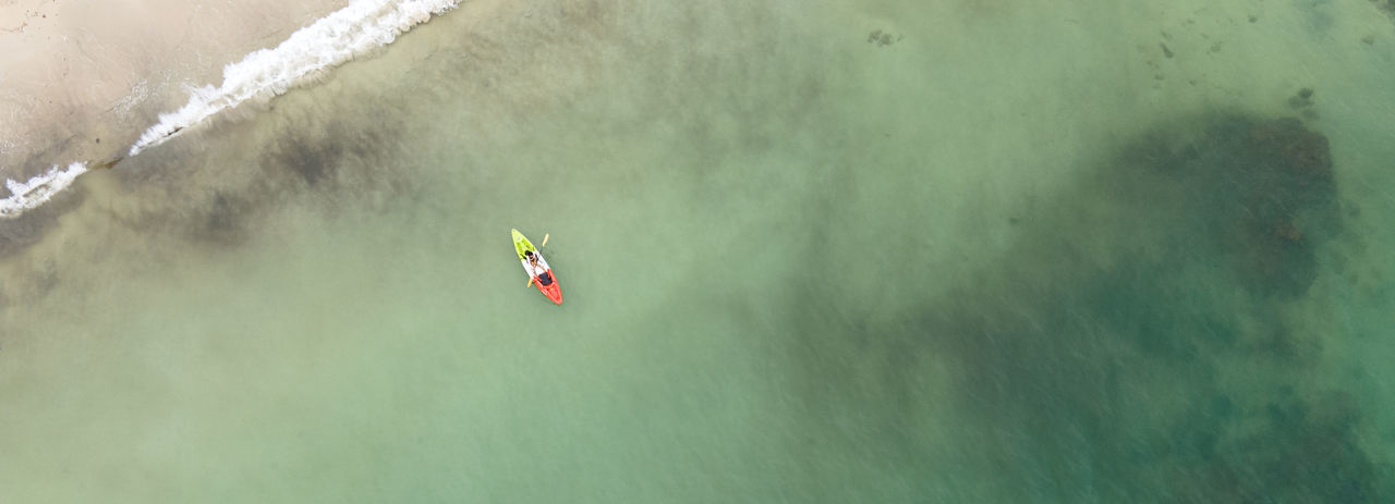 High angle view of umbrella in sea