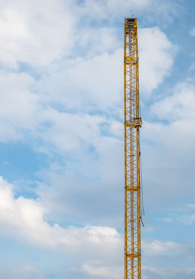 yellow crane on construction site Yellow Crane On Construction Site With A Plane And A Bird In Flight Construction Site Cloud - Sky Sky Crane - Construction Machinery Construction Industry Industry Tall - High Architecture Low Angle View Metal Day Built Structure Development Machinery Nature No People Outdoors Construction Machinery Tower Equipment Construction Equipment Global Communications