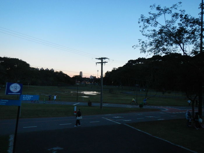 View of road against clear sky at sunset