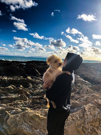 Just a man and his dog Dogs Man Sky One Person Cloud - Sky Real People Lifestyles Leisure Activity Standing Sunlight Water This Is My Skin