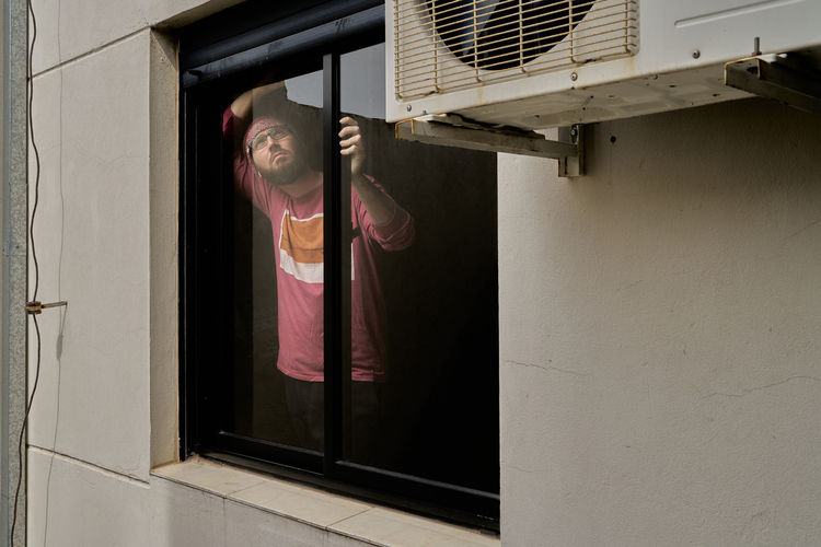 Reflection of woman on window