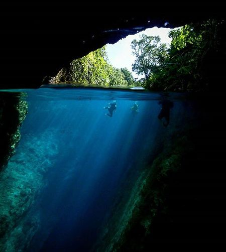 Locals Swim at Hinatuan Enchanted  River in Surigao del Sur province, Philippines . The Underwater part of the image might look as if it is out of focus but actually is not, the blur is caused by the mixture of salt Water in the surface and the fresh water coming from the depths of a Cave . Quite an Amazing place! Check my Facebook page at www.facebook.com/pablosquiza.photography to see unpublished pictures of this place. Photooftheday Picoftheday Wanderlust Instagood Instatravel Travel Explore Travelphotography Itsmorefuninthephilippines Pinoy ASIA Paradise Underwaterphotography Sunrays Tourism Roadtrip Adventure