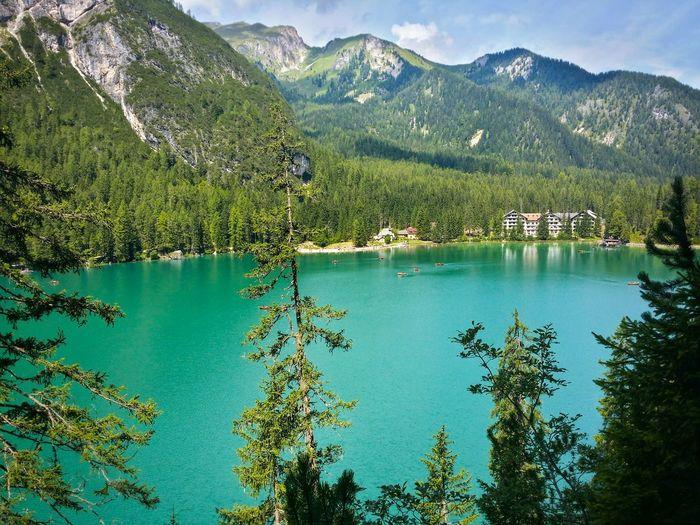 Calm Lake Against Moss Mountain Range