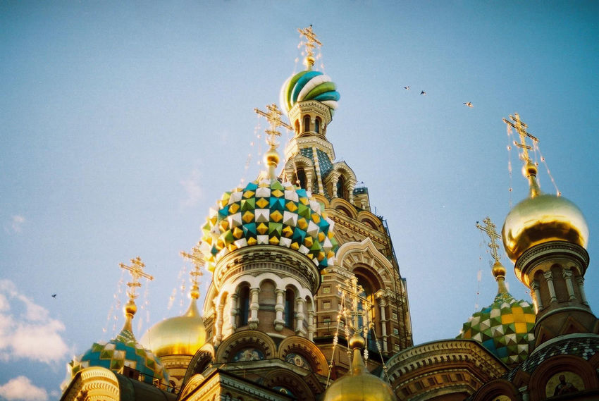 Analogue picture of the Church of the Savior on Blood in Saint Petersburg, Russia. Taken with a Canon AE-1 on a sunny day. Church Russia Saint Petersburg Sunlight Architecture Building Exterior Day Low Angle View No People Place Of Worship Religion Sculpture Sky Travel Destinations