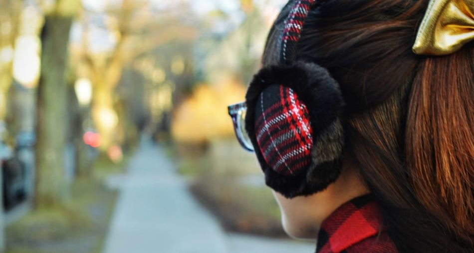 Close-up of woman wearing ear muff