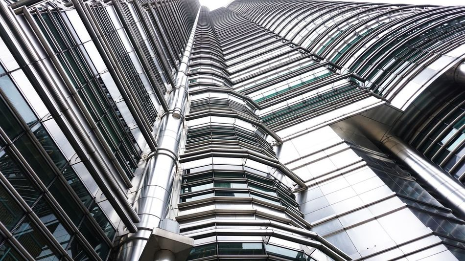Kuala Lumpur City Centre Twin Tower Architectural Feature Architecture Building Story Colors And Patterns Conformity Curve Day Development Full Frame Growth Low Angle View Modern Office Building Outdoors Repetition Sky Skyscraper Tall Tall - High