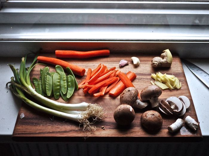 High angle view of vegetables on cutting board in kitchen