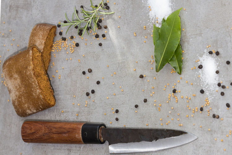 Close-up of food with spice and knife on cutting board