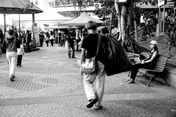 What's in your plastic bag? Streetphotography Real People Large Group Of People Outdoors Rear View Low Angle View Kuching Waterfront Blackandwhite Black & White Black And White Photography