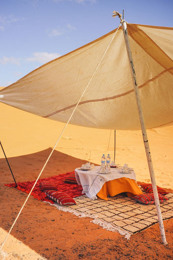 Lunch time in the middle of Sahara Desert Sky Day Tent Land Nature Sand Transportation No People Rope Textile Outdoors Sunlight Cloud - Sky Clothing Canvas Environment Drying Beach Architecture Security Desert Sahara Desert Yellow Color Sand Dune