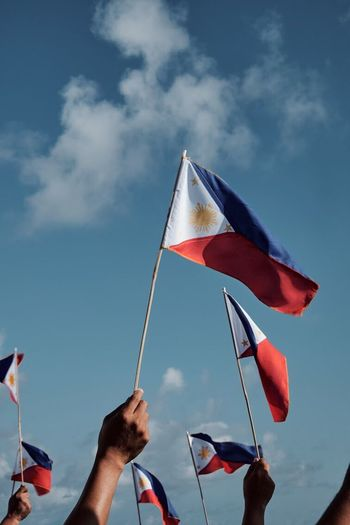 Philippine Independence Day Flag Patriotism Human Body Part Cloud - Sky Human Hand Wind Pride Holding Waving Sky Real People Outdoors Day Men One Person Only Men Adults Only Adult One Man Only People The Photojournalist - 2017 EyeEm Awards