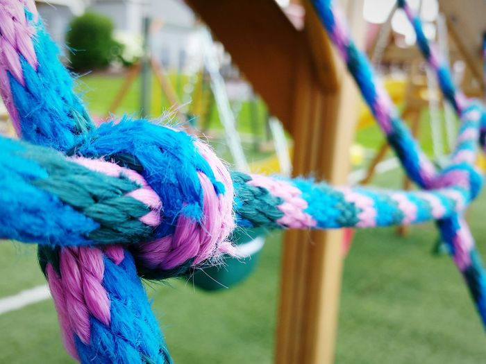 The EyeEm Collection Cargo Climb Colorful Knot Playground Playground Equipment Knotted Rope Multi Colored Blue Feather  Rope Close-up Outdoor Play Equipment Jungle Gym