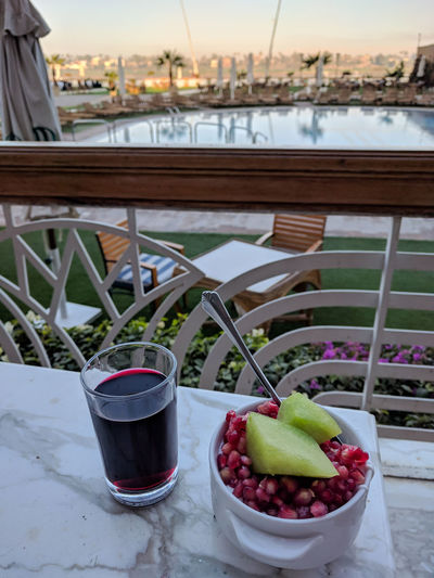 Juice Nile River Terrace Bowl Close-up Day Drink Drinking Glass Focus On Foreground Food Food And Drink Freshness Fruit Healthy Eating Hibiscus Hotel Breakfast No People Outdoors Pomegranate Poolside Table Water