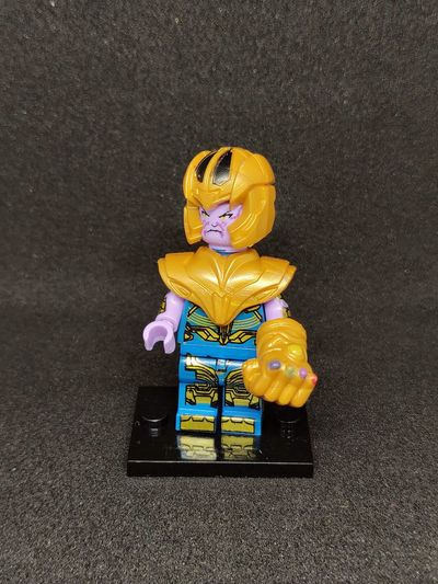 Thanos - Infinity War Iron Man Captain America Civil War Marvel Avangers Infinity War Thanos Sand Beach Close-up Male Likeness Human Representation Buddha Female Likeness Sculpture Snowman Pedestrian Sign Idol Figurine  Virgin Mary Golden Color Sculpted Craft Flaming Torch Angel Carving - Craft Product Woolen Statue ArtWork Art