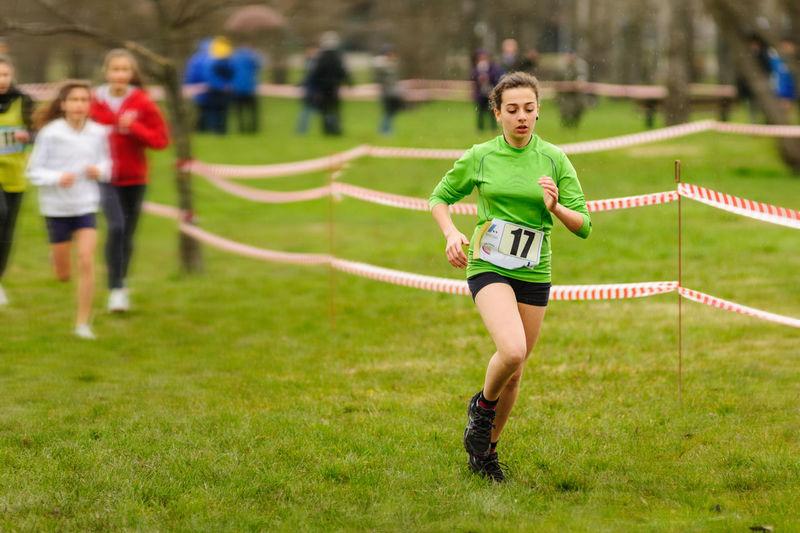 Athlete running at grassy field