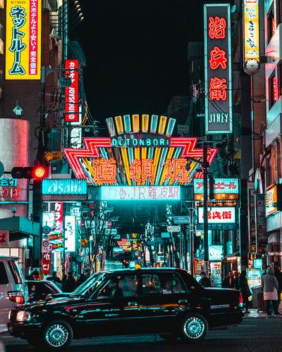 Taxi passing by Dontonbori Gate in Osaka, Japan Japan OSAKA Osaka,Japan Teal And Orange Built Structure City City Life Dontonbori Illuminated Moody Night Outdoors Street The Street Photographer - 2018 EyeEm Awards The Traveler - 2018 EyeEm Awards