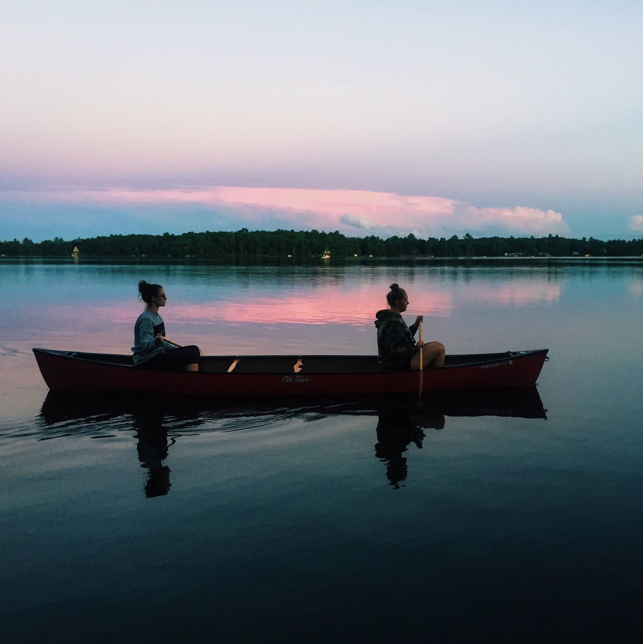reflection, water, sunset, nature, men, real people, two people, togetherness, full length, silhouette, leisure activity, lake, beauty in nature, sky, waterfront, tranquility, sitting, outdoors, nautical vessel, scenics, lifestyles, women, rowing, oar, day, people