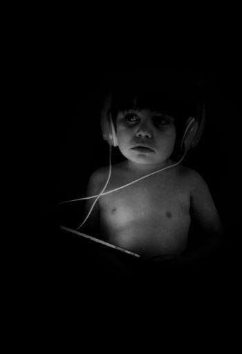 Portrait of woman in darkroom