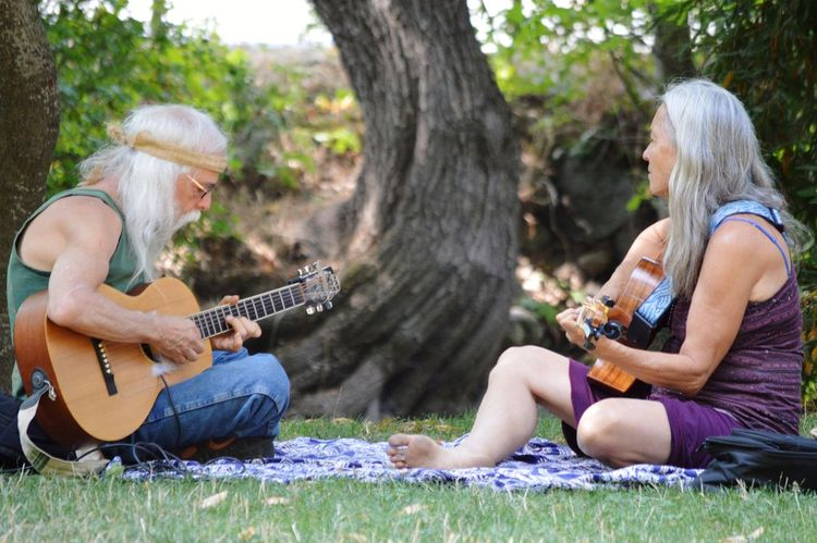Guitar Music Plucking An Instrument Two People Musical Instrument Guitarist Playing Acoustic Guitar Sitting Heterosexual Couple Arts Culture And Entertainment Adult Leisure Activity Women Musician Togetherness String Instrument Couple - Relationship Ashland, OR Oregon Lithia Park