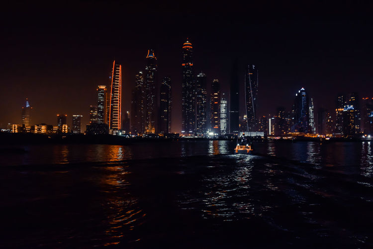 DUBAI, UNITED ARAB EMIRATES - UAE - Asia 23 APRIL 2016: Skyscrapers of City Marina at skyline view lights and for expensive property, high-end luxurious star hotel Arabian, Skyscrapers, Nighttime, Metropolis, Residential Architectural-construction, Aerial, Lake, Illumination, Architecture Building Exterior Built Structure Cityscape Dark, Water, Resort, Evening, Mall, Exterior, Colorful Downtown, Arabic-town, Luxury, Tall-structure Financial District  Highrise-tower, Urban-architecture, Travel-business, Tourism-industry Illuminated Landmark, Blue, Al-street-road, Scene, Futuristic Modern, Skyscraper, Beautiful-cityscape Nightlife, Entertainment-center, Gulf-tour, Big, Facade, Festive-season Office Building Exterior Outdoors Reflection Rooftop, Office, Bay, Club, Dusk, Tallest-buildings Scenic, Life, Illuminated, Wealth-prosperity, Beach, Holiday-vacation Skyscraper Tall - High Tower Urban Skyline Water Waterfront #urbanana: The Urban Playground EyeEmNewHere Capture Tomorrow