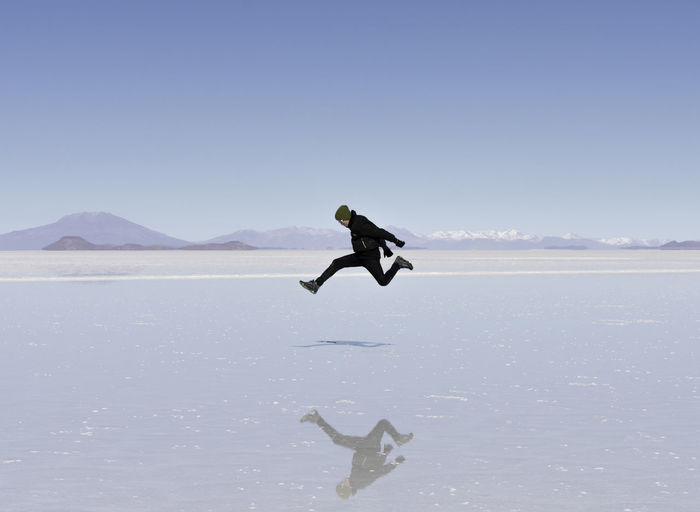 Keep on rockin' Jumping Sky Water Full Length Nature Mid-air One Person Day Scenics - Nature Men Tranquil Scene Real People Mountain Clear Sky Jumping Beauty In Nature Tranquility Leisure Activity Copy Space Sea Outdoors Salt Flat Jump Youth Joy Joyful Joyful Moments Celebration Young Adult Young EyeEm EyeEm Best Shots EyeEm Selects EyeEm Gallery EyeEm Travel Photography