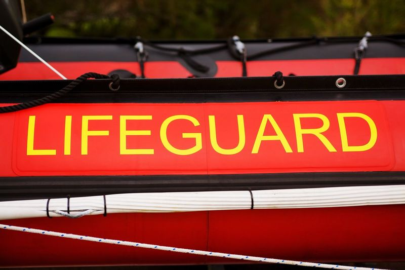 Life guard. Red Text No People Close-up Boat Lifeguard  Safety
