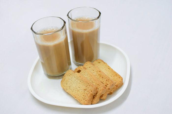 Tea... Anyone ? 🌄😊 InMakin! EyeEm Selects Tea Tea Time Tea - Hot Drink Rusk Food And Drink White Background Studio Shot Indoors  Drink Plate Drinking Glass Freshness Food Close-up Freshness Milk Tea Refreshment Randomness
