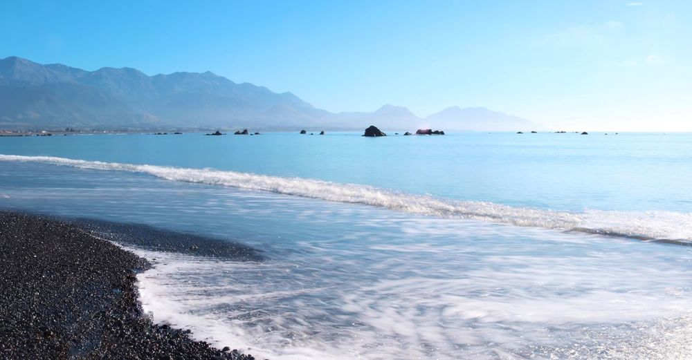 Water Sea Scenics - Nature Mountain Beauty In Nature Sky Tranquil Scene Tranquility Land Nature Day Outdoors Kaikoura Kaikoura New Zealand Waves Morning Sun Morning Blue Mountains New Zealand No People Landscape Beach Motion Idyllic Aquatic Sport Surfing Sport Wave