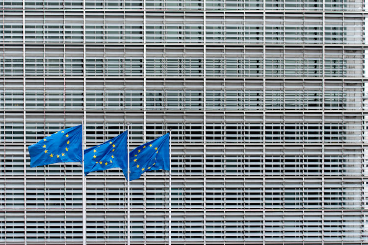 View of modern building with three european flags