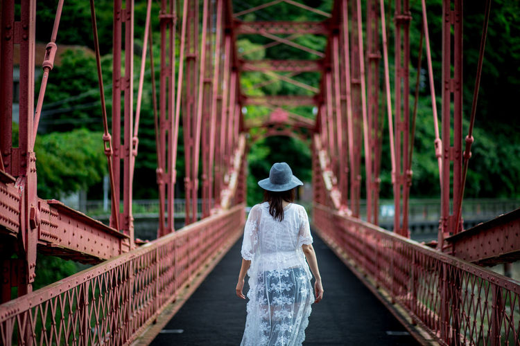 RED BRIDGE #womanportrait #赤い橋 Adult Architecture Bridge Bridge - Man Made Structure Built Structure Clothing Connection Day Footbridge Hairstyle Hat Leisure Activity Lifestyles One Person Outdoors Railing Real People Rear View Standing Three Quarter Length Transportation Walking